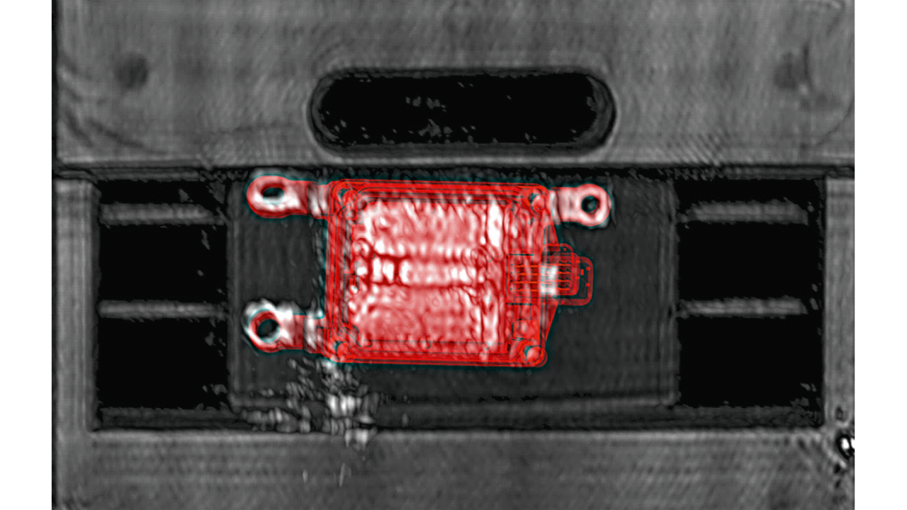 Millimeterwave image of the vehicle front with rear-mounted radar sensor and overlaid CAD data