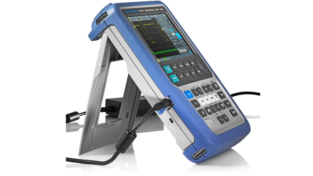 R&S®Scope Rider handheld oscilloscope with attached power supply