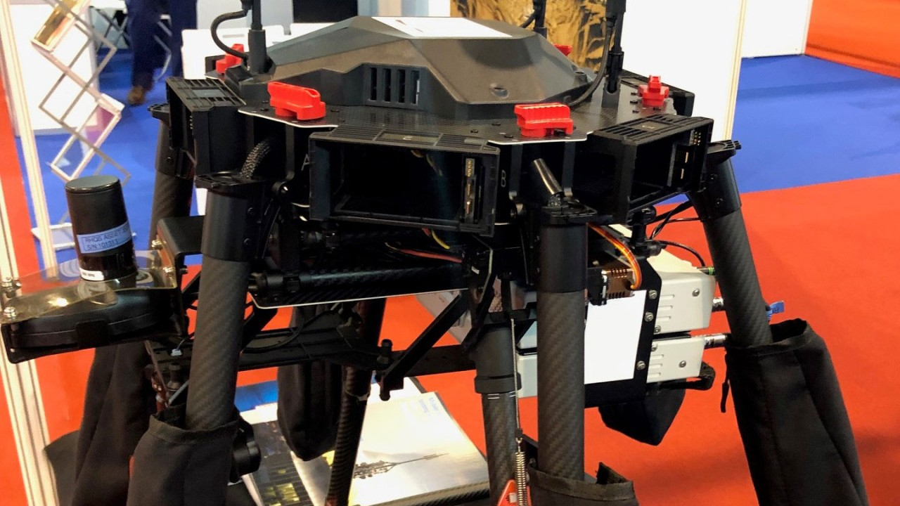A drone equipped with two R&S®TSMA6 scanners and two QualiPoc Android smartphones